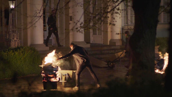 Agents-burn-documents-at-Potsdam-house-Counterpart-STARZ-Season-1-Episode-6-Act-Like-Youve-Been-Here-Before.jpg