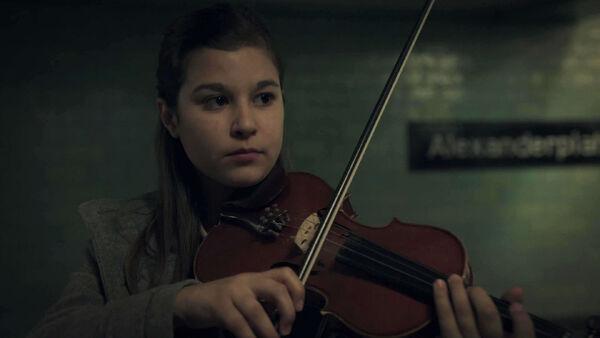 Alessandra-Reggiani-as-Young-Nadia-plays-in-Alexanderplatz-station-Counterpart-STARZ-Season-1-Episode-2-Birds-of-a-Feather.jpg