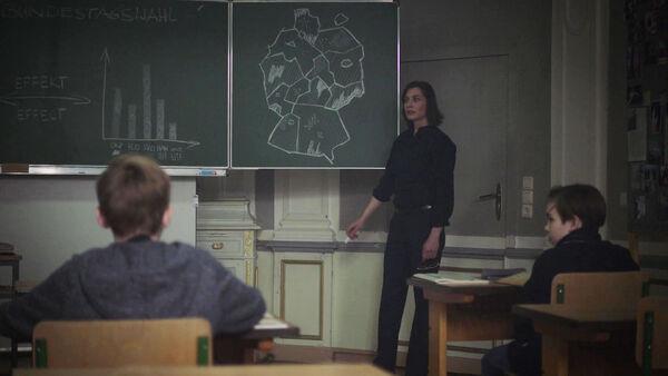 Christiane-Paul-Mira-Teaches-Politics-Counterpart-STARZ-Season-1-Episode-8-Love-the-Lie.jpg