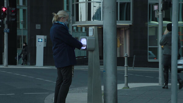 Dimension-Two-Woman-at-curbside-Hygiene-Station-Counterpart--Season-1-Episode-4-Both-Sides-Now.jpg