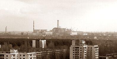 View of Chernobyl taken from Pripyat zoomed.jpg