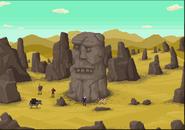 Full stone statue desert