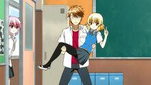 Kenji carrying Roka in his arms..jpg