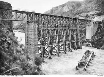 A railway bridge over the Yarmuk River, destroyed by the enemy and rebuilt by the Canadian Bridging Company - 1919 מסילת הרכבת מרפיח לבאר שבע - גשר העץ מעל נחל הבשור