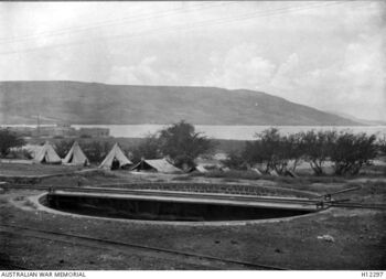 A railway turntable close to the station with the Lake in the background - SLake Tiberias תחנת סיבוב קטרים בתחנת צמח - 1918
