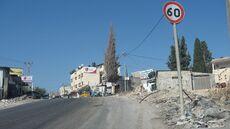 Zoldan Monument Right to entrance to Al Funduq