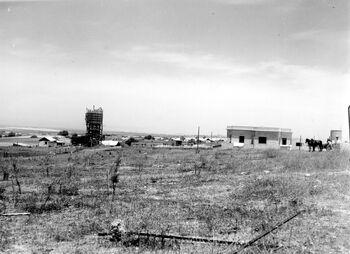 MOSHAV KFAR HAROEH WITH THE NEW WATER TOWER UNDER CONSTRUCTION. בניית מאגר מים במושב כפר הרואה בעמק חפר.D477-123