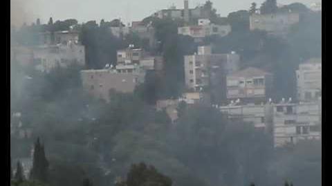 Airplane spraying foam over fire in Haifa