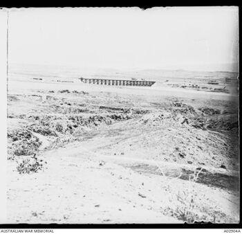 A distant view of the railway viaduct over the Wadu Ghuzze - Jul 1917 הגשר על נהר הבשור