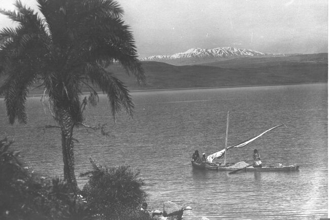 VIEW OF THE KINNERETH IN 1920, SNOW CAPPED IN BACKGROUND. COURTESY OF AMERICAN COLONY.
