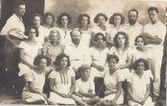Sh. Z. Pugachov among a group of girl students and teachers Zvi Zohar, Arieh Allweil and Dov Yoffe at Kfar Yeladim (1)