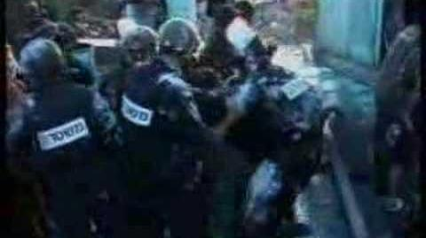 אלימות_שוטרים_בבית_הכנסת_בכפר_דרום_-_www.YADKATIF.com