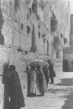 WORSHIPPERS PRAYING AT THE WAILING WALL IN JERUSALEM. מתפללים בכותל המערבי בעיר העתיקה בירושלים.D11-028