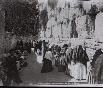 WORSHIPPERS AT THE WESTERN WALL (WAILING WALL) IN THE OLD CITY OF JERUSALEM. (COURTESY OF AMERICAN COLONY) מתפללים בכותל המערבי בעיר העתיקה בירושלים.D826-075