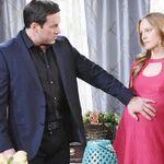 Stefan touches Abigail's pregnant belly.jpeg