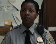 Sonja Crosby as Gotham Desk Cop