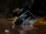 Jonathan Kent's photo falls into the Genesis Chamber liquid