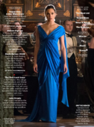 Diana Prince stands in a blue dress promotional still