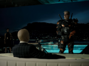 Deathstroke grabs a glass of wine to celebrate.png