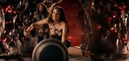 Wonder Woman using her shied to stop Steppenwolf