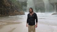 Arthur stands on an island in the Hidden Sea promotional still