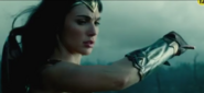 Diana perceives and deflects a bullet