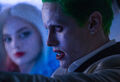 Harley Quinn watches as the Joker drives