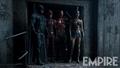 Batman, Flash, Cyborg and Wonder Woman stand in a doorway