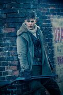 Trevor leaning against wall