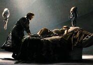 Jor-El helping Lara with her pregnancy