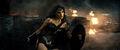 Wonder Woman leaning against rubble