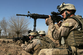 Marines take cover and open up on the enemy.jpg