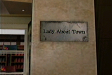 Dead rising lady about town sign