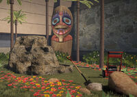 Silver Strip Luaii Wauwii Statue in back near maintenence room with lawn mower and shovel