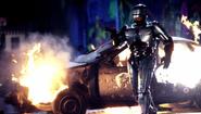 RoboCop - RoboCop walking out of his blown up police car
