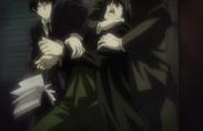 Gevanni restrains Mikami