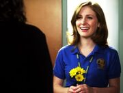 329px-Holly J In Her Degrassi Uniform Looking At Fiona With Three Yellow Flowers In Her Hand.jpg