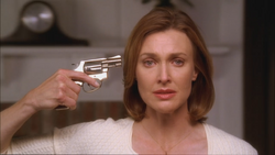 1x01 Mary Alice Young revolver suicide.png