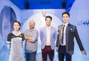 Bryan Dechart and David Cage with the statues of Kara and Connor