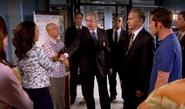 Agent Davis shakes Maria's hand