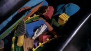 Dex puts Brigid in toy box 507