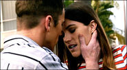 Quinn kisses Debra