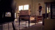 Dexter in Travis Marshall's apartment