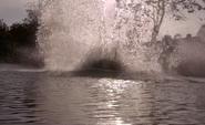 Water splashes as car hits lake S8E4