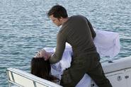 Dexter buries Debra at sea