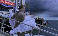 Dexter carries Debra's body to his boat