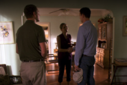3 Beth shakes Travis hand