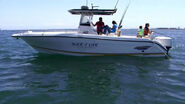Dexter on his boat with Debra, Cody, and Astor