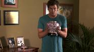 38 Dexter holds Vera's urn S4E6
