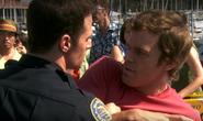 Cop tries to stop Dexter from scene 6